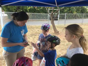 Zoo Knoxville's Bethany Dunn allows Aiden Thornton to touch a lizard from their collection while Savannah Bradley and Ireland Hubbs look on at the second annual Western Heights Community Fair at Beaumont Magnet School on Oct. 13.